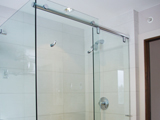 frameless shower slider with header